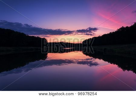 Beautiful summer sunset at the river in forest
