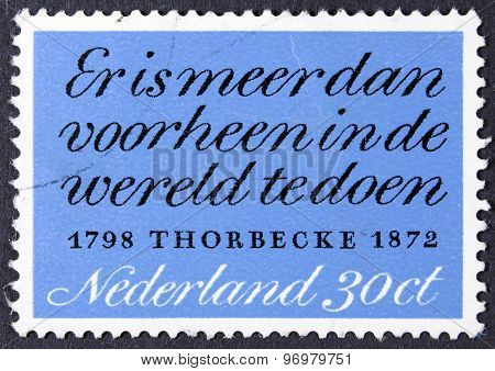 Postage stamp isolated on black.