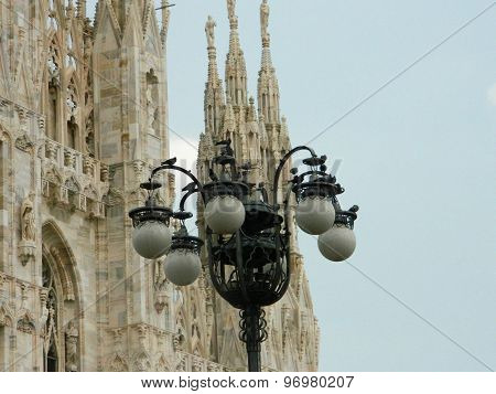 Street Lights In Front Of The Milan Duomo In Piazza Duomo.