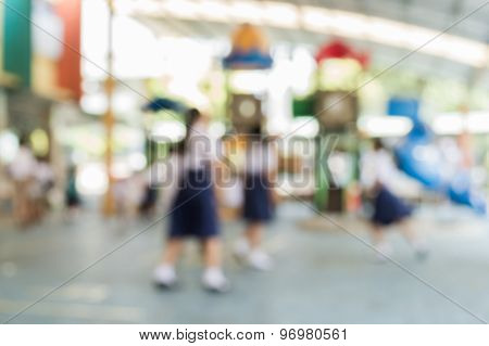 Blurred Schoolchild Are Playing In The Playground