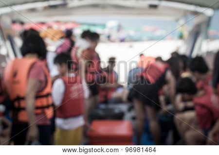 Blurred Tourist With Life Jacket In The Boat