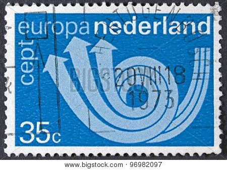 Symbol of post on a postage stamp.