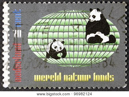 Black and white panda bear on a postage stamp