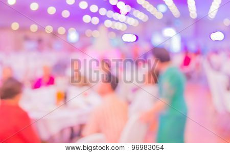 Blurred Image Of Large Dining Table Set For Wedding.