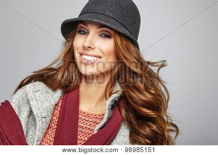 Young brunette woman in autumn color. Studio shoot