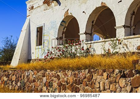Old Building by Stone Wall