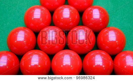 Red snooker balls and green table