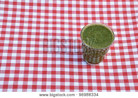 Spinach Smoothie On Red-white