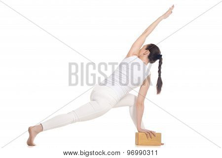 Yogi Female Exercising With Wood Brick