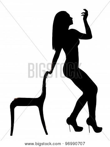 Silhouette Of A Woman Dancing Near The Chair