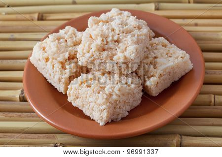 Coconut Candy Cocada On Brown Plate