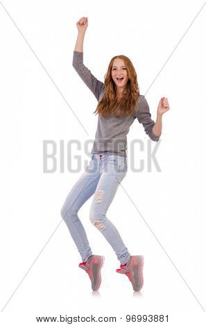 Cute smiling girl in gray blouse and jeans isolated on white