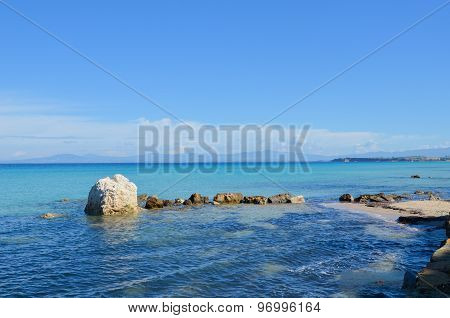 Beautiful Turquoise Transparent Mediterranean Sea With Rocks And White Sand