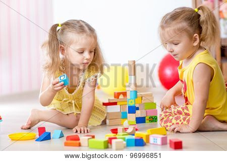 children playing wooden toys at home