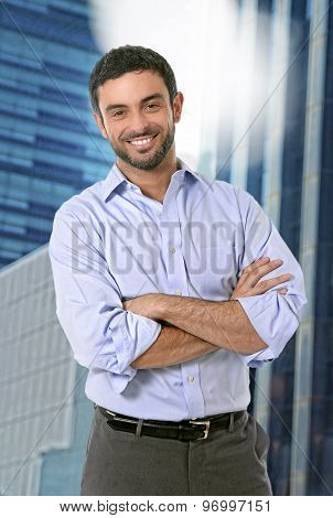 Attractive Business Man Posing Happy In Corporate Portrait Outdoors On Financial District