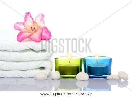 Gladiola,White Towel,Candles And White River Stones