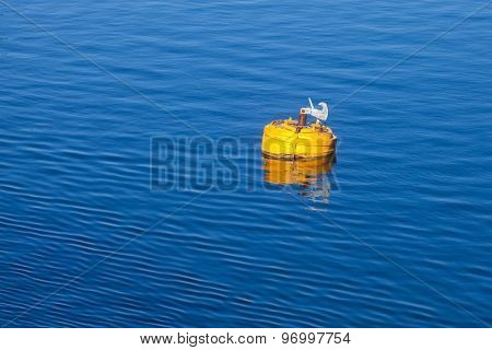 Yellow Mooring Buoy With Hook On Blue Sea Water