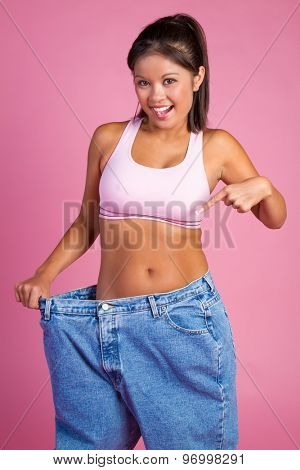Asian weight loss woman holding big pants