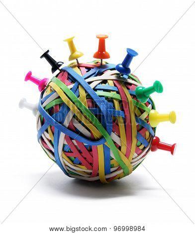 Pushpins On Rubberband Ball