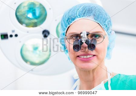 Orthopedic surgeon with special glasses in operating room
