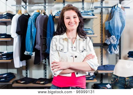Woman buying clothes in shop