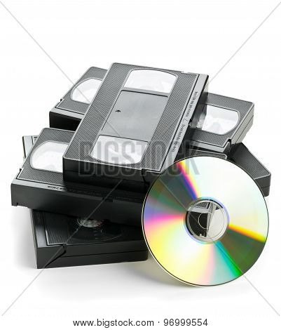 Heap Of Analog Video Cassettes With Dvd Disc