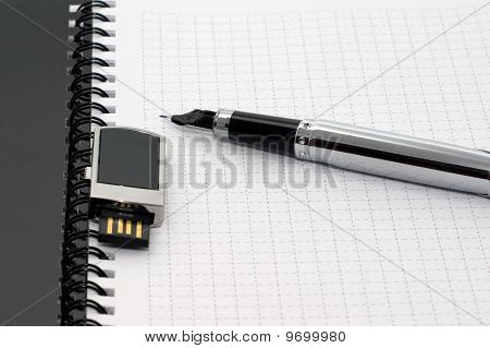 Rollerball Pen And Flash Memory On Notepad
