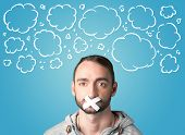 pic of taboo  - Funny person with taped mouth and hand drawn clouds around head - JPG