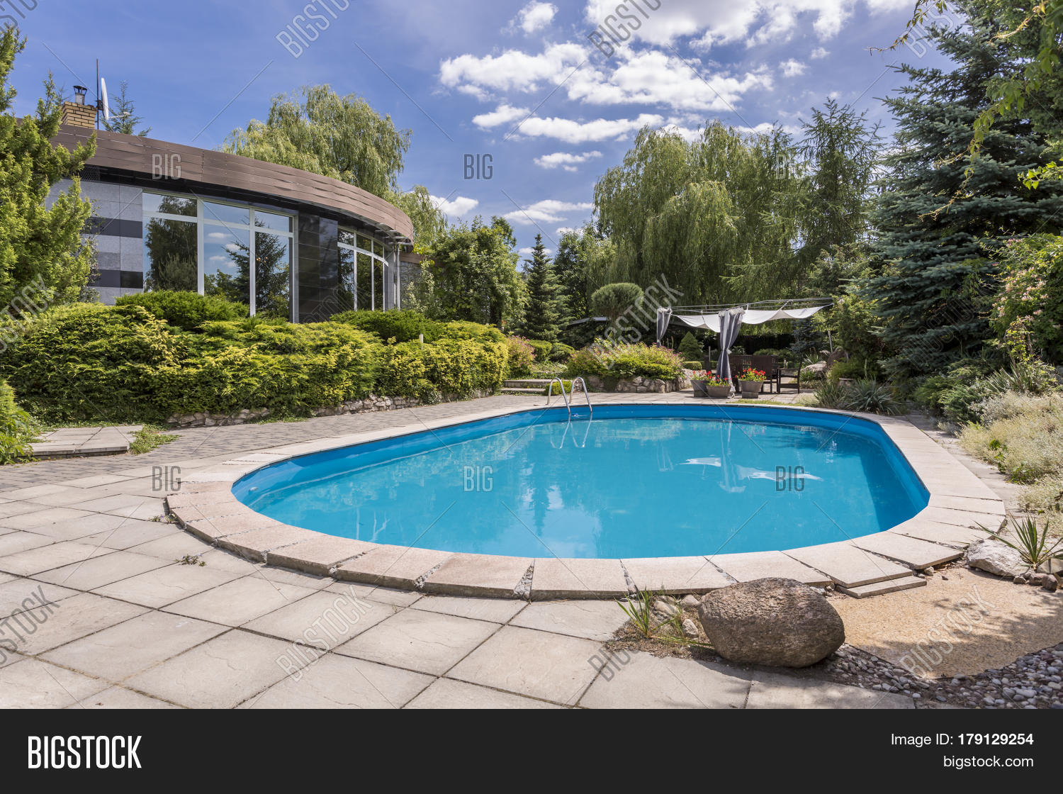 Oval swimming pool big garden image photo bigstock for Big swimming pools for gardens