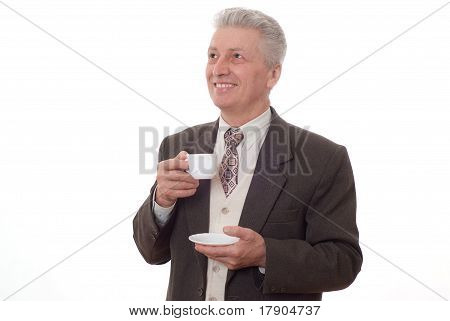 Businessman Drinking From A Cup On A White