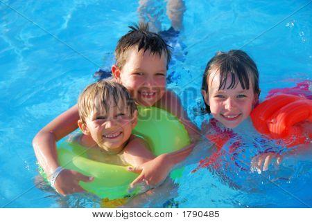 Three Children In Pool