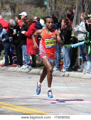 BOSTON - APRIL 18 : Runners race up Heartbreak Hill during the Boston Marathon April 18, 2011 in Bos