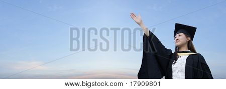 Asian lady graduate raising hand