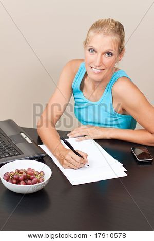 Young Pretty Student Works On Her Essay