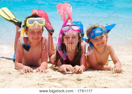 Happy Divers On A Beach