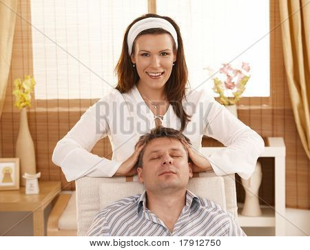 Man getting relaxing head massage in dayspa.?