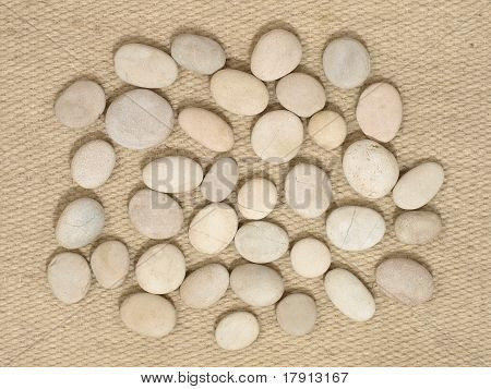 Small Stones On A Camal Wool.