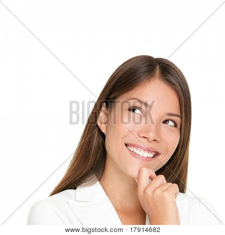 thinking woman isolated on white background looking up smiling having an idea. Beautiful young mixed race woman in business suit