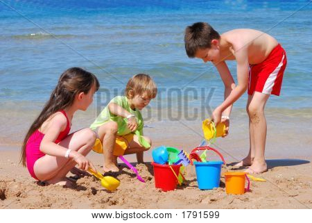 Children Playing At The Beach