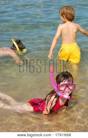 Children Snorkeling At Beach