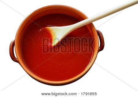 Terracotta Pot And Wooden Spoon With Tomato Sauce