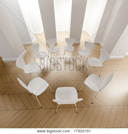 Big room with a circle of white chairs