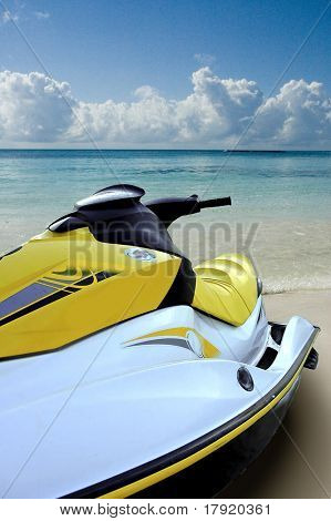 Jet ski on the beach looking at the sea