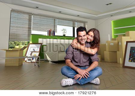 Joven pareja feliz después de trasladarse en su nuevo hogar. Las imágenes de los cuadros son míos y el labe