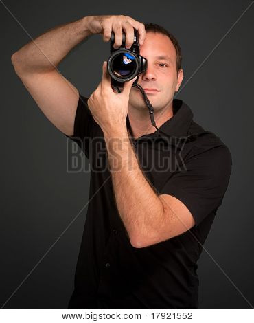 Man in black taking a picture with a photo camera