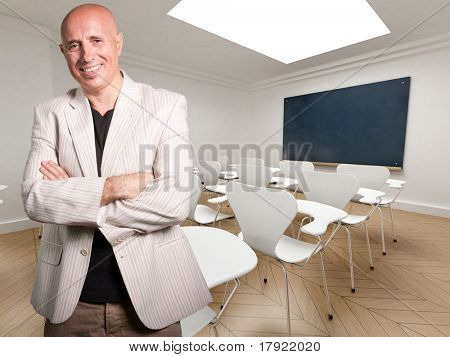 Mature teacher happily smiling in an empty classroom