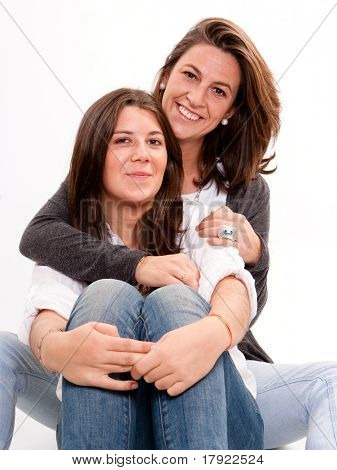 Isolated image of a mother holding her teenage daughter