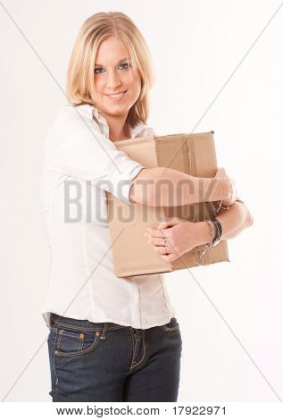 Blonde young  woman embracing a cardboard package