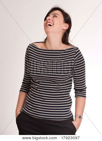 Portrait of an attractive laughing brunette wearing a stripped t-shirt