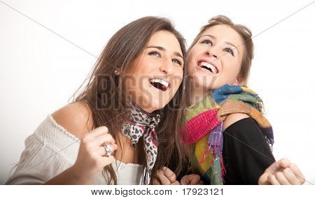 Young sisters one blond, the other brunette laughing together